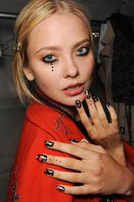 Quite a departure from the muted colors we've been seeing at Fashion Week, Libertine went in a more edgy direction with this makeup and manicure by butter LONDON.
