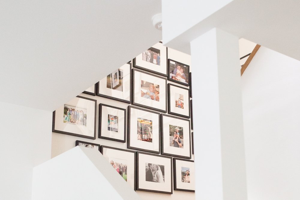 GALLERY wallS  Those family photos or favorite eclectic collection: artfully and professional curated and hung.