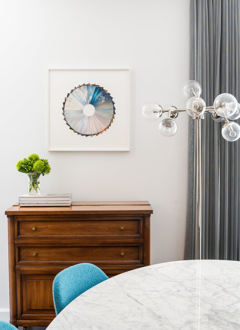 Andres Galeano's  collaged photos adds a sophisticated conversation piece to the dining room.