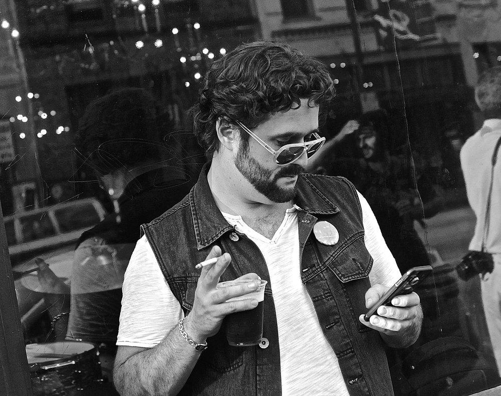 guy checking phone.jpg
