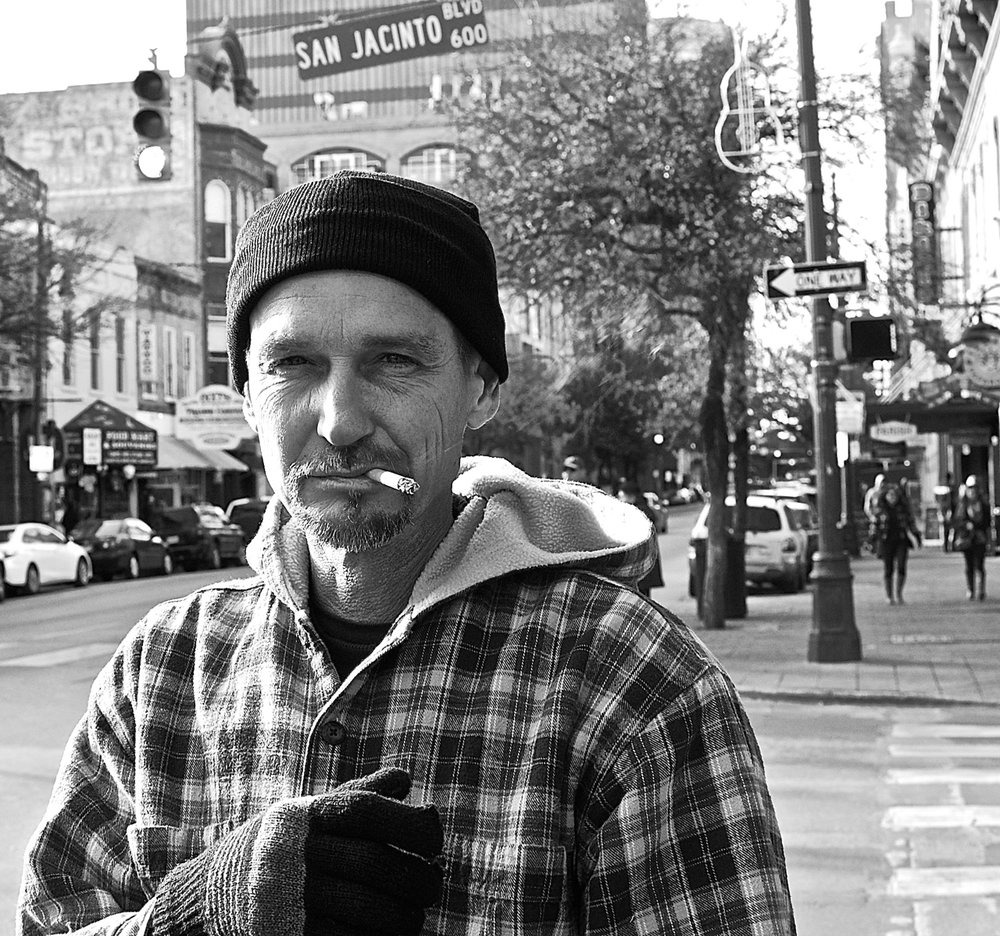 Sixth Street portrait: a cigarette against the cold