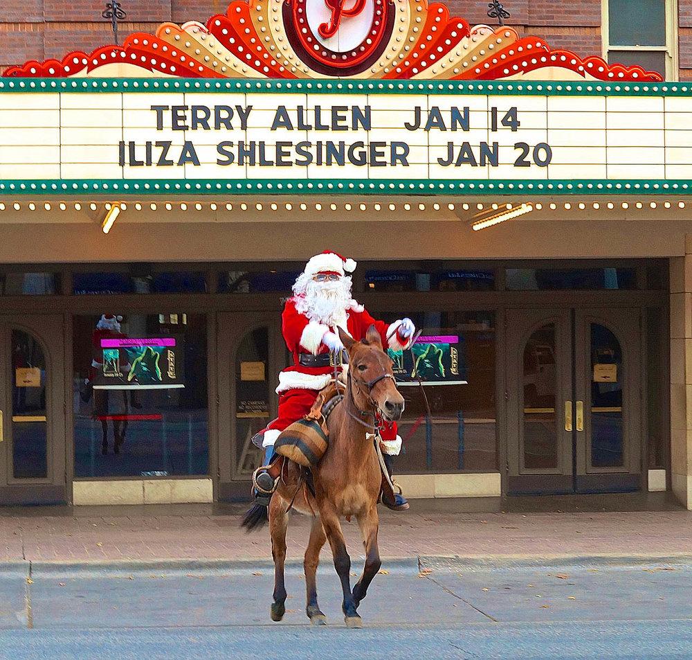 Santa Claus crosses Congress Avenue