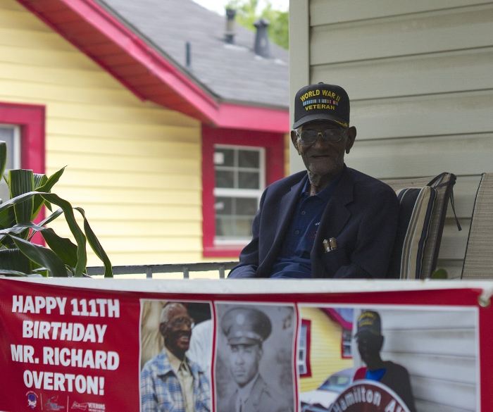 At 111 years of age, Richard Overton is America's oldest living World War II veteran. Austin Mayor Steve Adler declared Overton's birthday, May 11, as Richard Overton Day in the city and announced that the street on which Overton lives, Hamilton Avenue, was temporarily being renamed Richard Overton Avenue.  Overton, who is recovering from pneumonia, is once again a familiar sight on his front porch after a recent hospital stay. Caregivers continue to ask for donations at  www.gofundme.com/Help-Richard-Overton to keep Overton living in his home instead of in a nursing home.