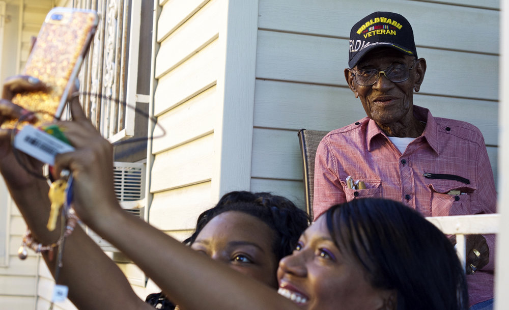 From selfies snapped beside the porch to photos posed on the porch, everyone clamored to get their picture taken with Richard Overton during his 112th birthday party on May 11, 2018, at his East Austin home.