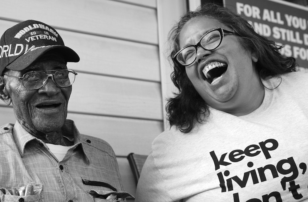 Austinites stood in line in Richard Overton's front yard on May 11, 2018, to climb the porch steps and pose for photos with America's oldest living World War II survivor on his 112th birthday.