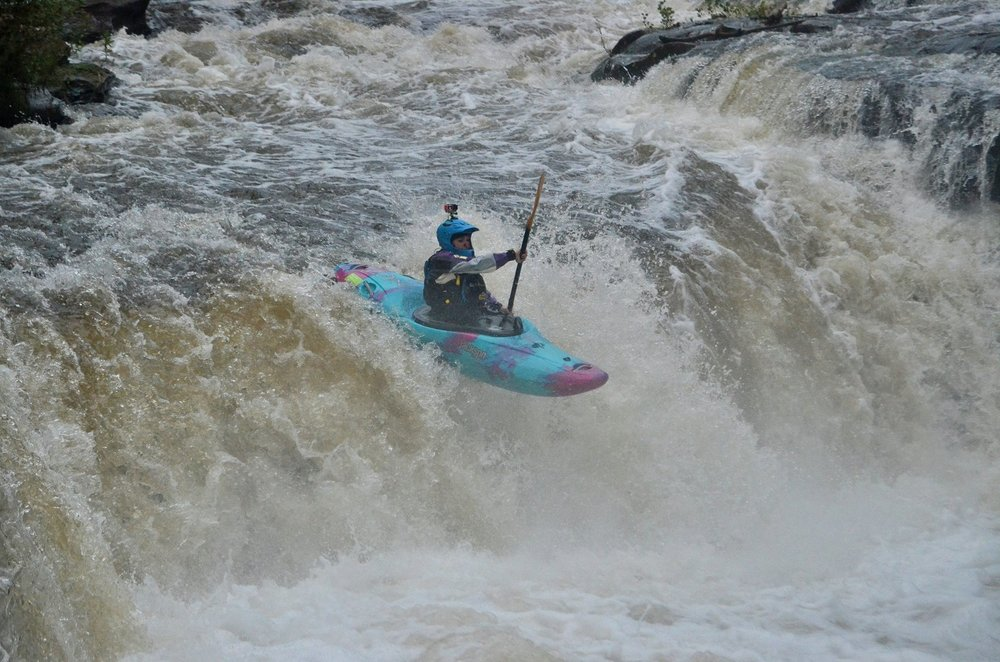 Paddler Alison Gillam, sends Rookie Drop on the Sheraton Section of the Cuyahoga River. For many paddlers, this is their first chance to run a clean drop, while working on their stroke timing.