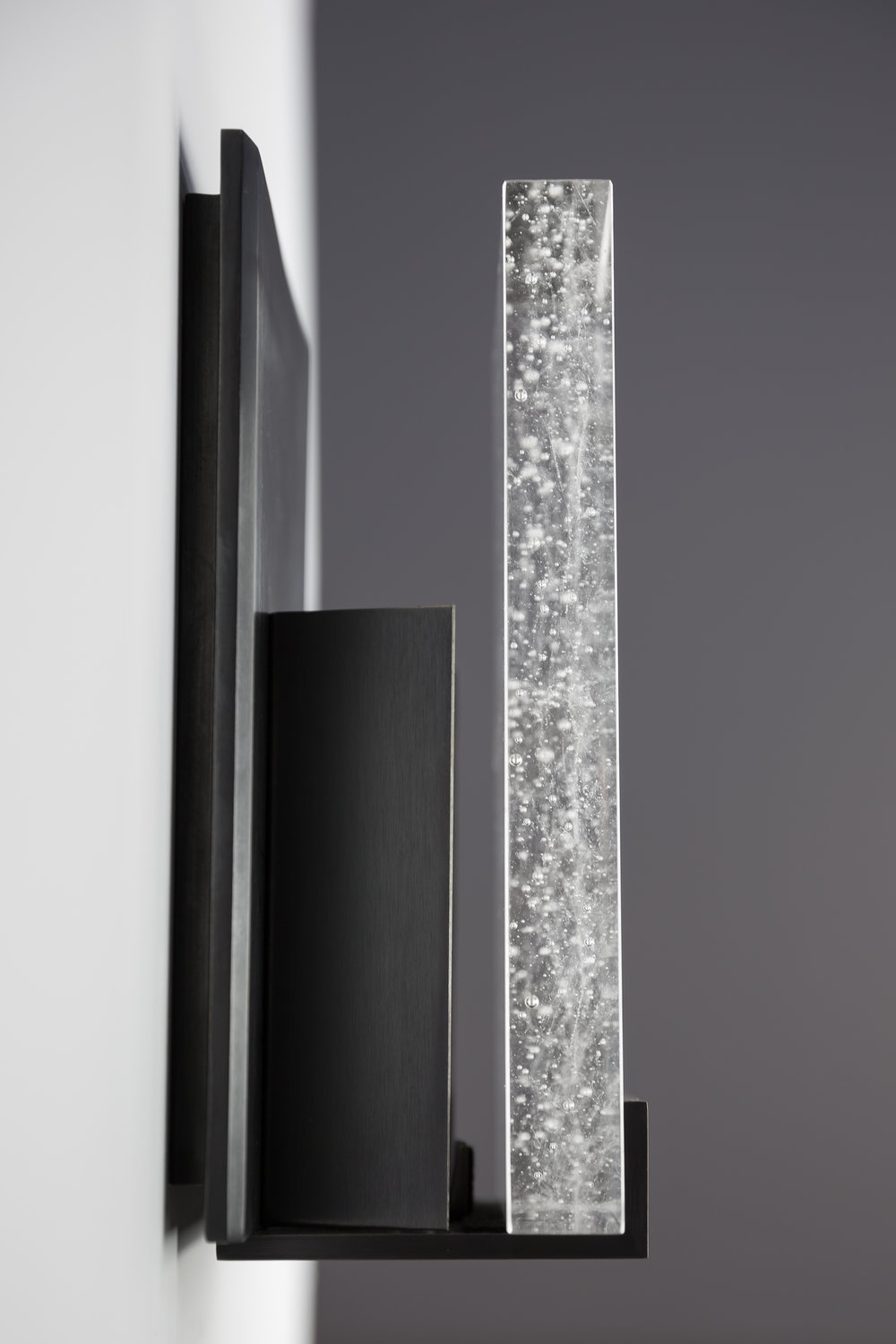 Shown in Dark Bronze and Cast Crystal Glass