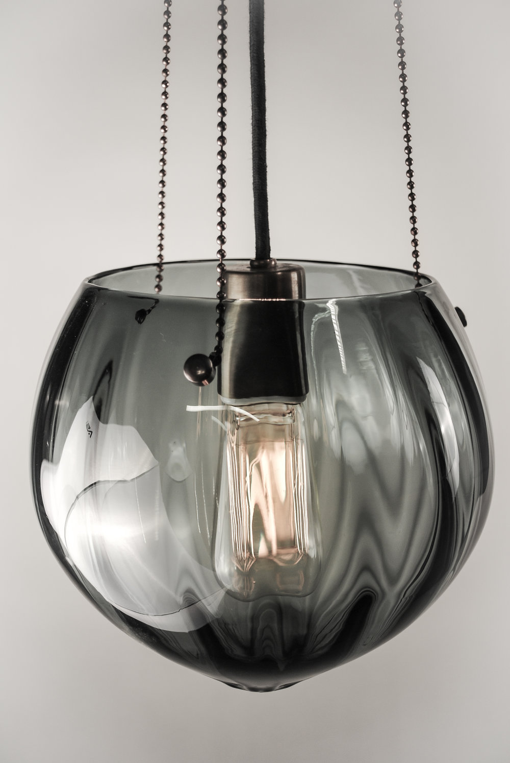Shown in Dark Bronze and Gradient Grey Glass