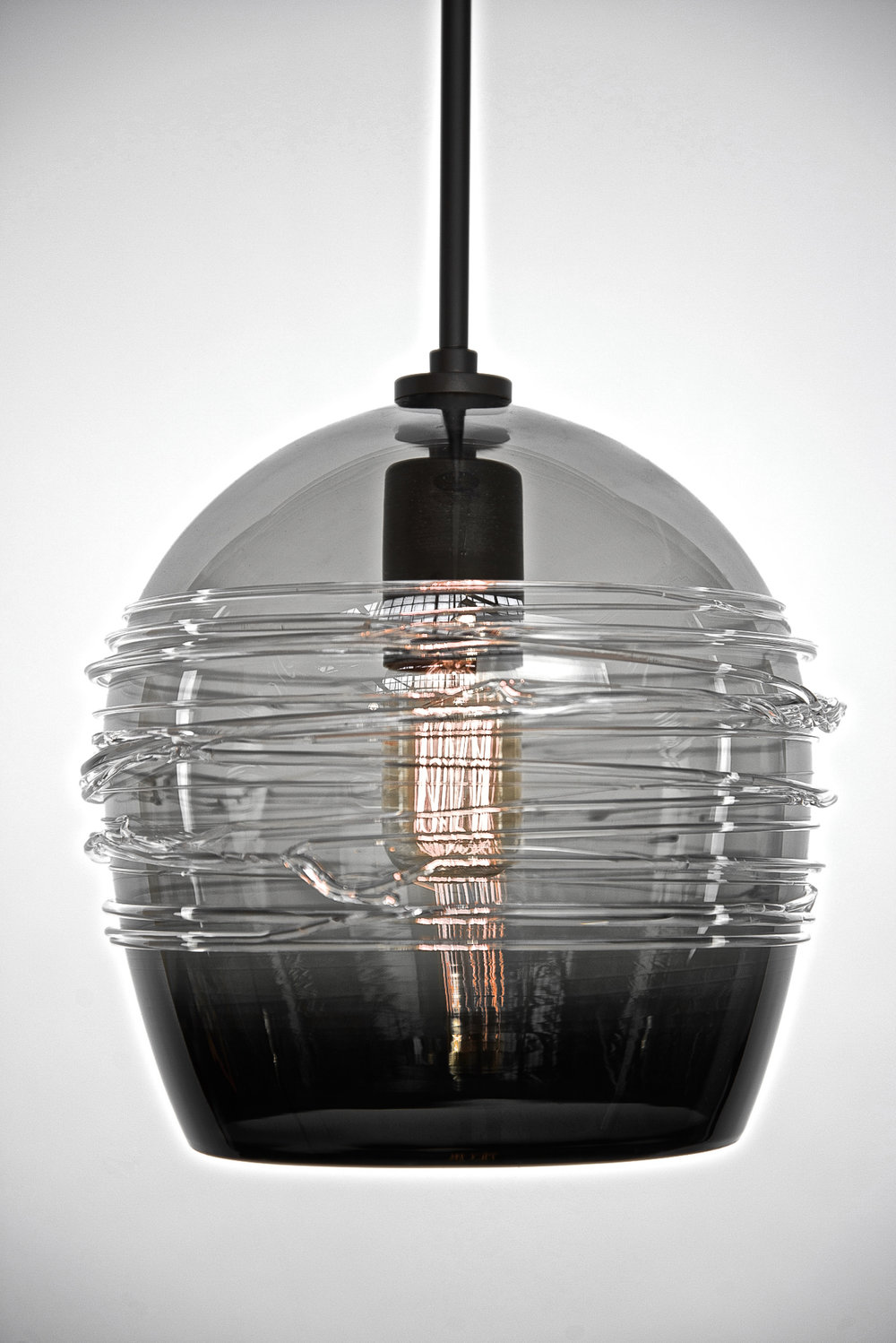 Shown in Dark Bronze with Clear Blown Glass