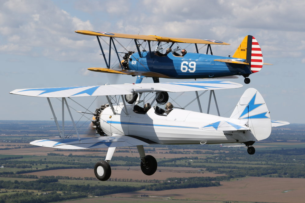 Greg Largen (Blue Stearman) & Randy Hardy (White Stearman)                 Combined they have over 9,000 hours of flying time