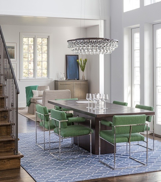 A light-filled contemporary California dining room by Mead Quin features the 1188 dining chair in springy green fabric. photo: David Duncan Livingston