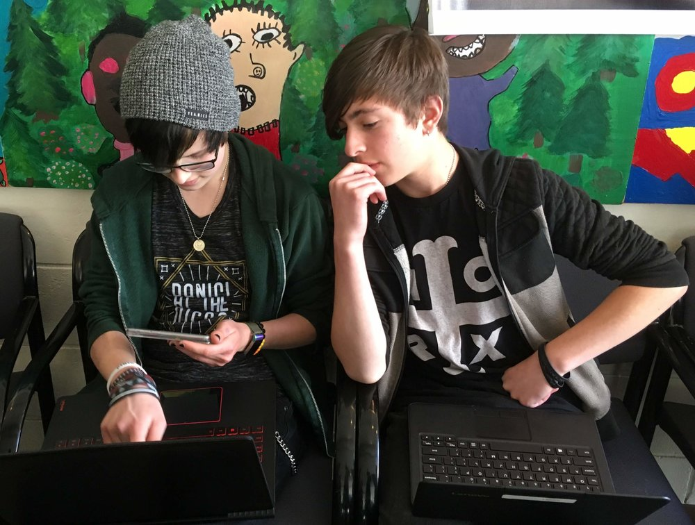 Two students working on computers