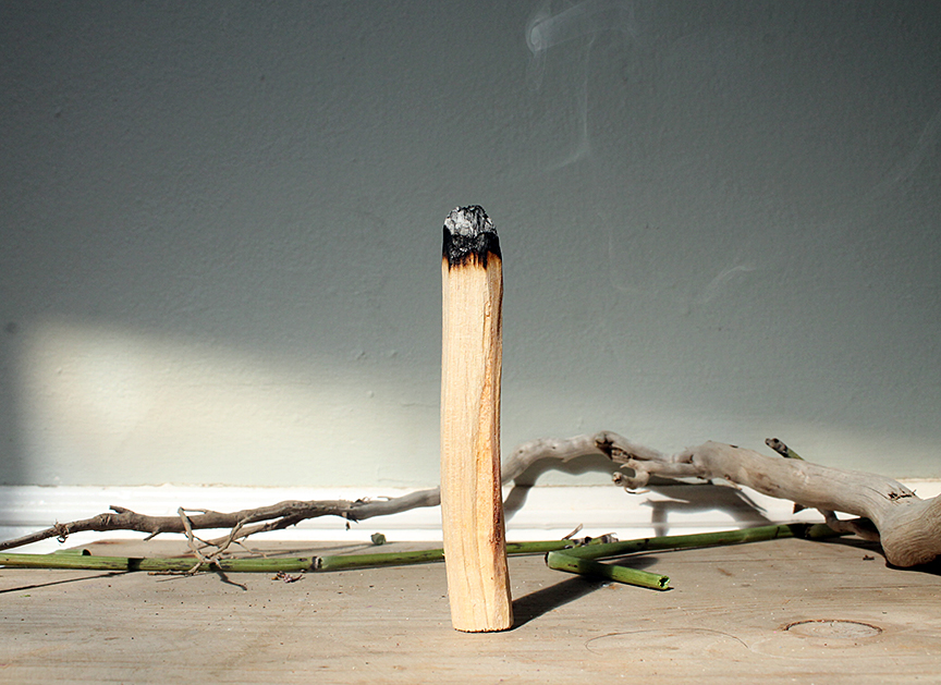 burning-palo-santo-incense-zouz.jpg