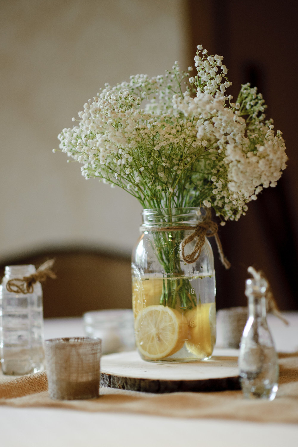 Baby's breath and lemons for the centerpieces