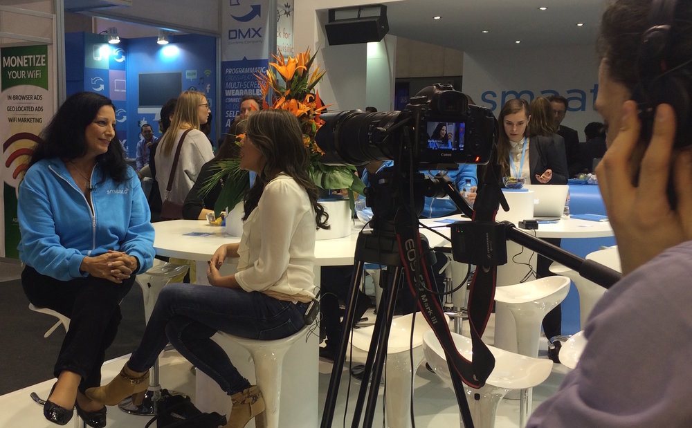 Laura Bolos conducting an interview at Mobile World Congress