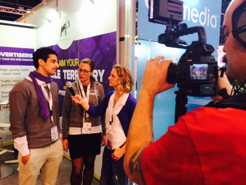 Chelsea Andrews conducting an interview at Mobile World Congress