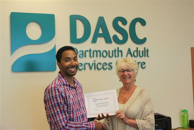Rodney Small of Common Good Solutions Inc. presents the Buy Social certificate to Cathy Deagle-Gammon, Executive Director of Dartmouth Adult Services Centre. Aug. 2015.