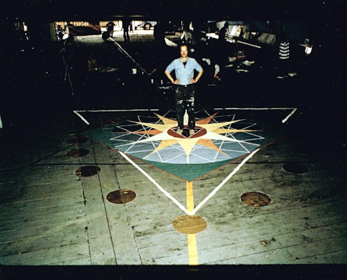 Installed on the floor of the Governor's Island Ferry Terminal in 1981 as part of the installation of art for the Foot Ball, an art party celebrating the body-based logic of the foot-inch system of measurement.  I have drawn dozens of these mandalas, generally by scratching into the earth someplace. Each time I begin by finding, as accurately as I can, a line on the earth parallel to the axis mundi, the meridian line – i visualize a specific line of longitude through whatever point i have decided is the center of the circle.  And then, using sticks and string, i unfold the sacred geometry that manifests the pattern of life in that place, on those days when we gather.