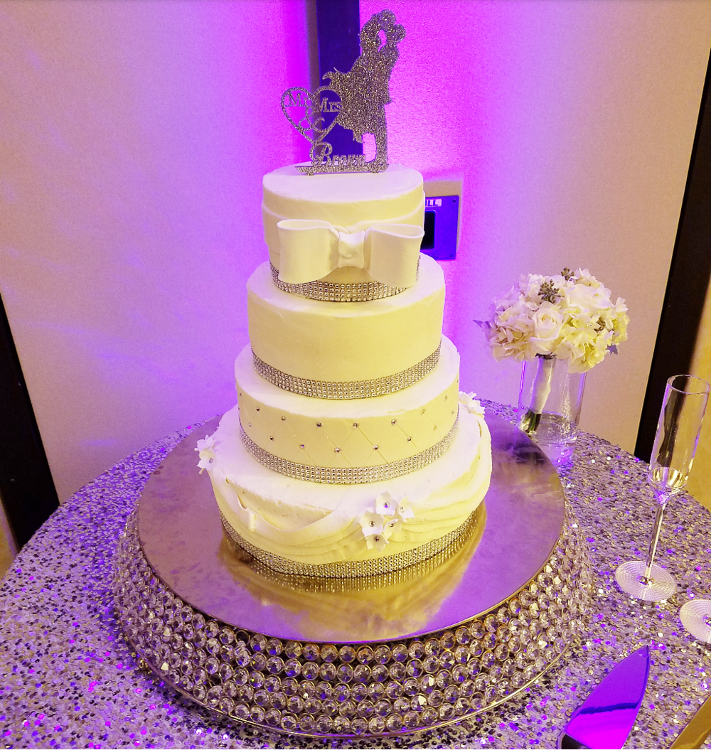 4 tier white wedding cake.png