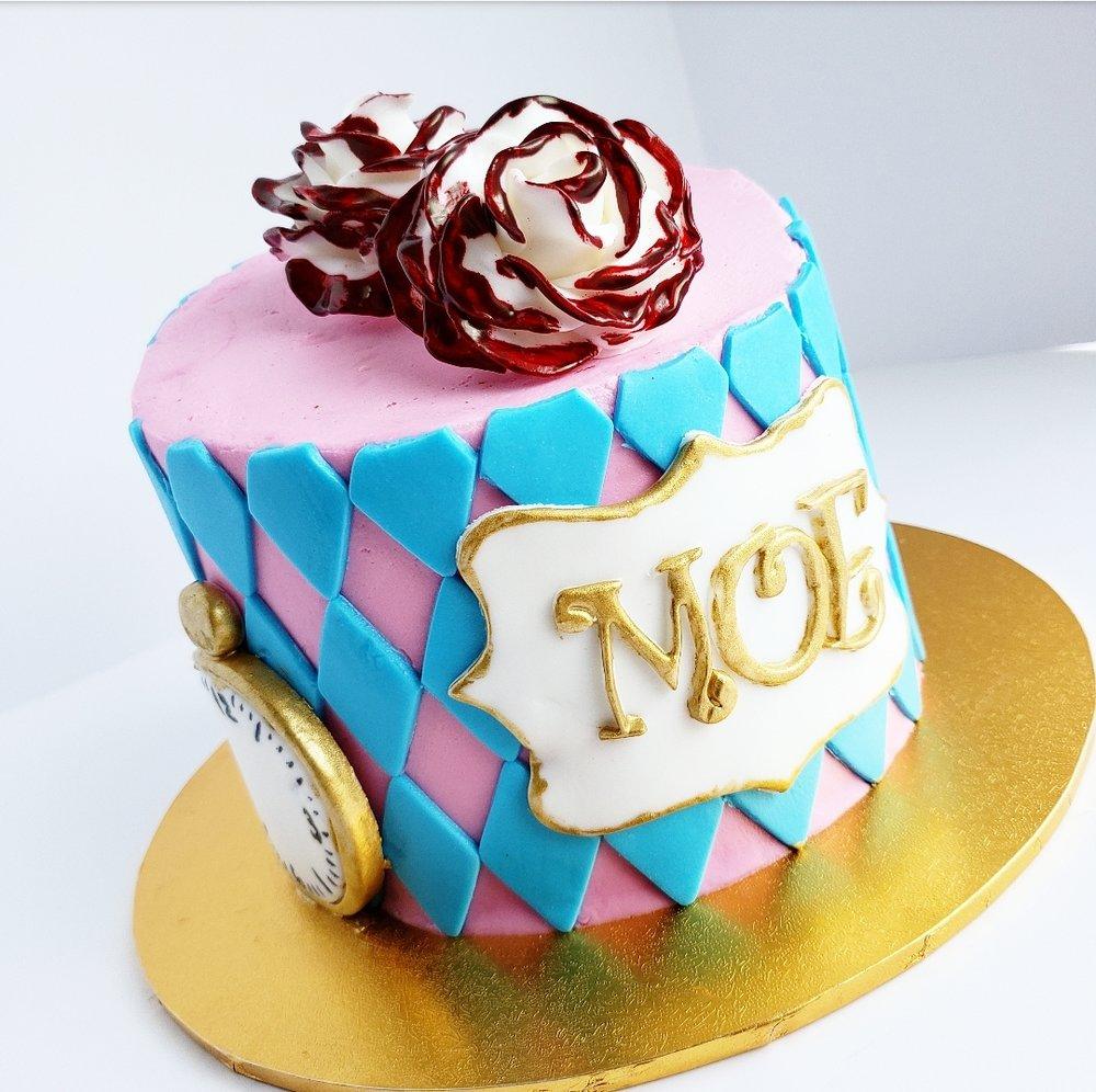 topsy turvy alice in wonderland birthday cake.jpg