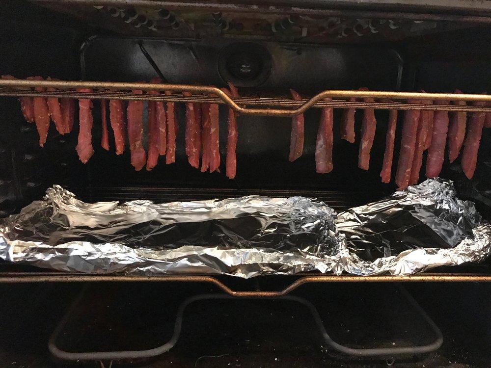 Set skewers in a way so the beef is hanging.