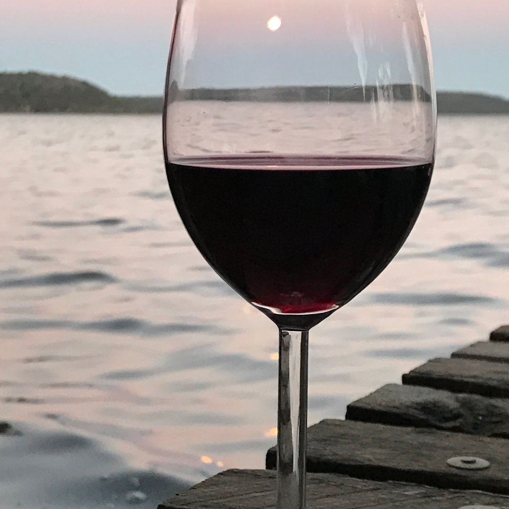 Wine watching the supermoon on the jetty