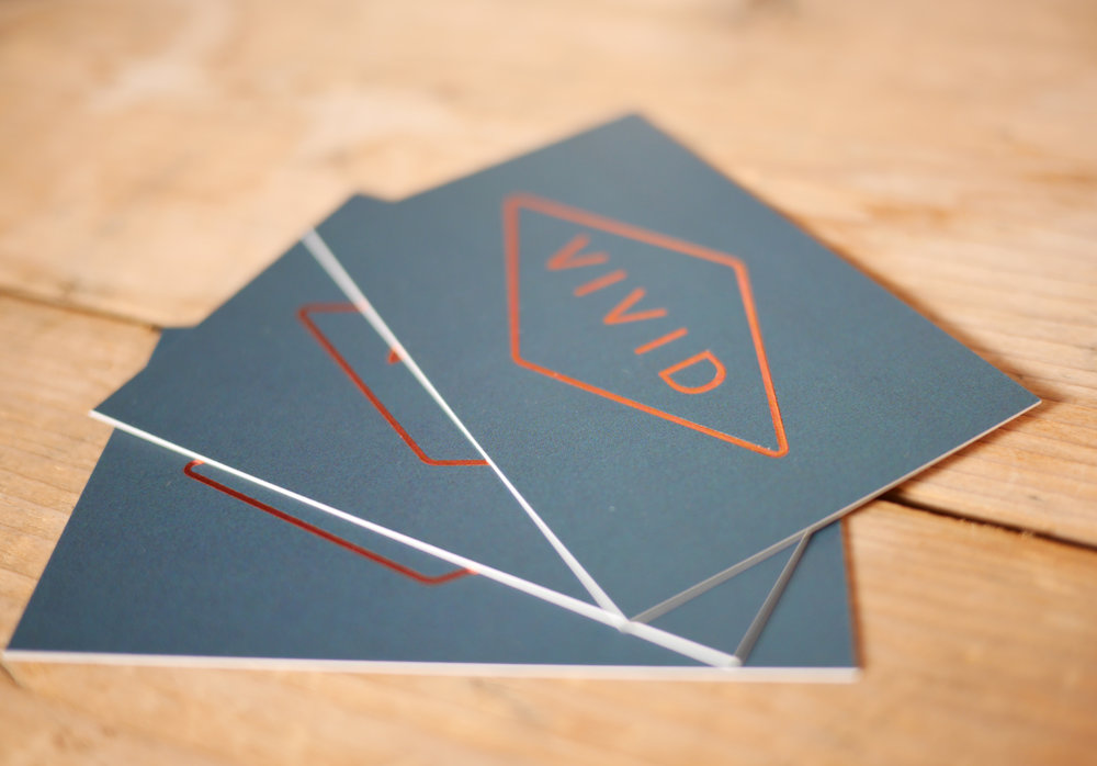 Vivid Kitchen business cards on table.jpg