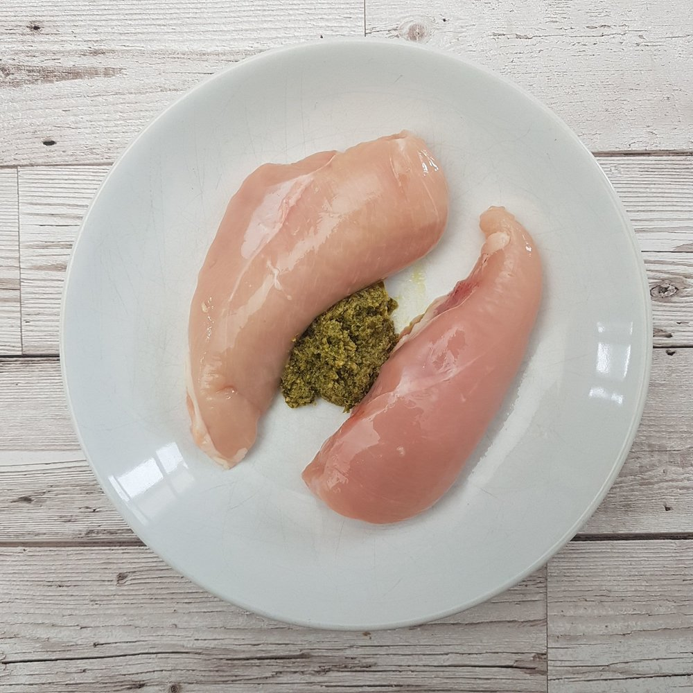 Coat the chicken breasts with 2 tbsp pesto