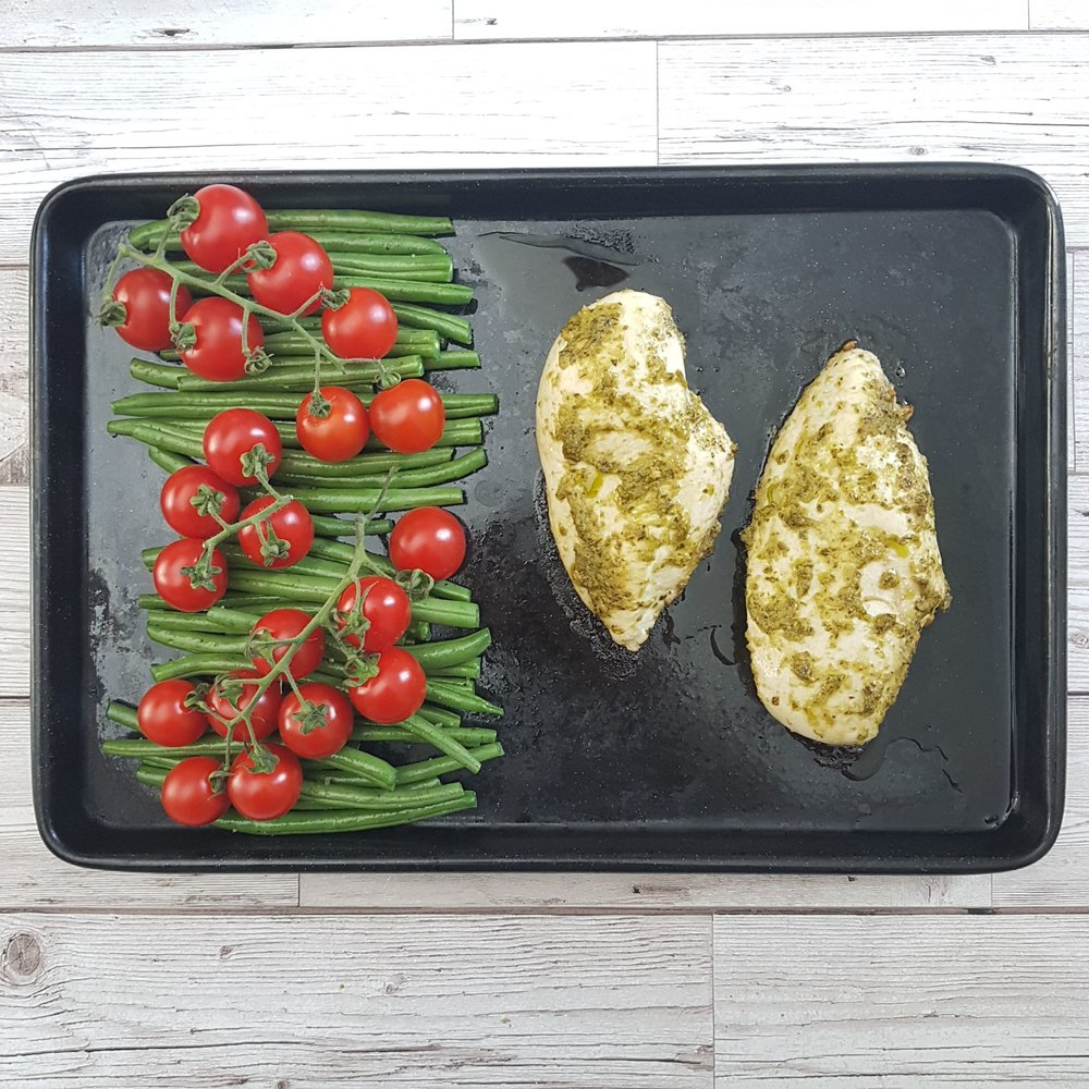 Then add the cherry tomatoes on top of the green beans. Place in the oven and bake for a further 20 minutes