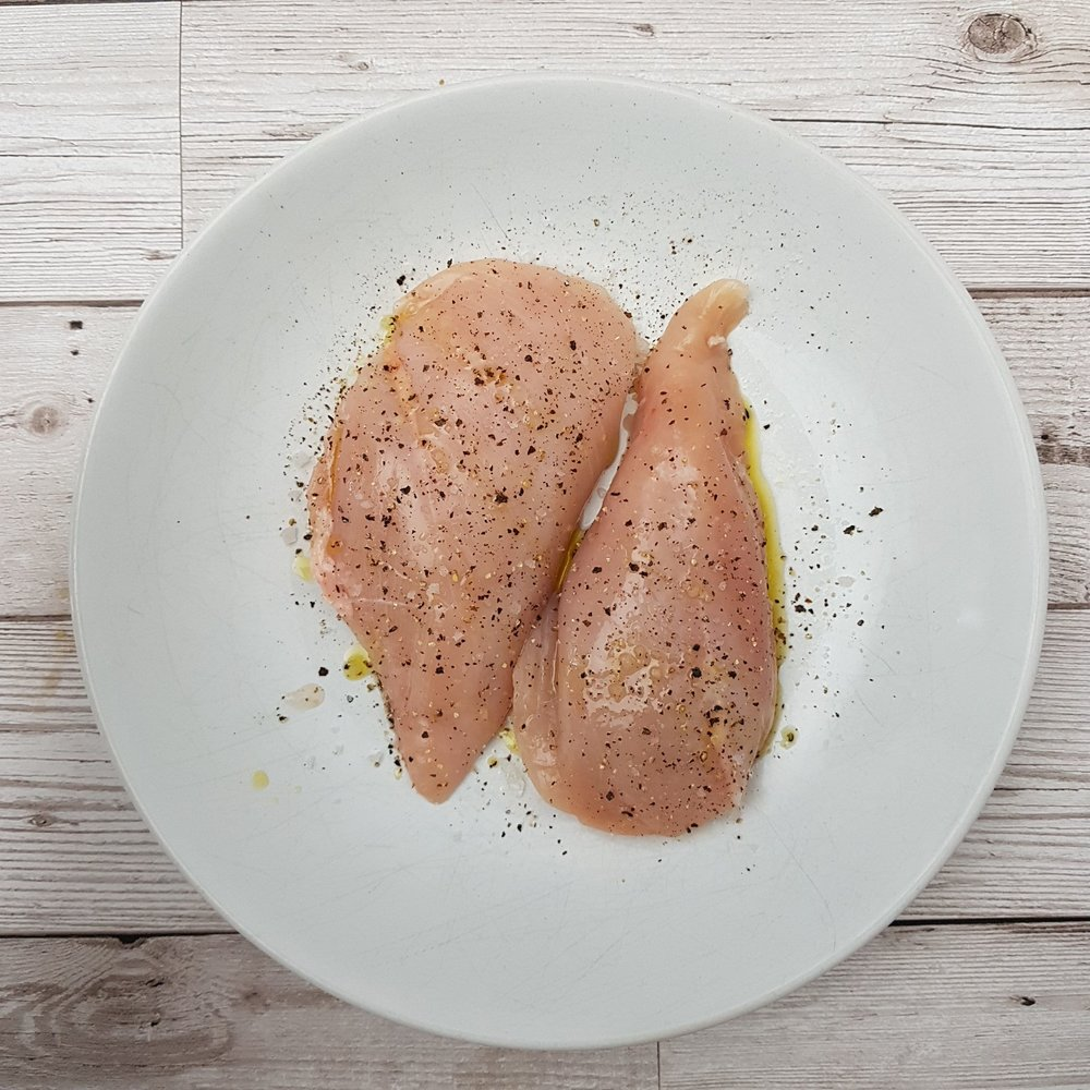 1.	Add the chicken breast to a bowl and season with 1 tsp olive oil and a pinch salt and pepper