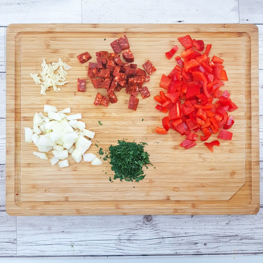 Prep the ingredients. Chop the onion, chorizo and bell pepper in to small pieces, then mince the garlic and finely chop the parsley if using