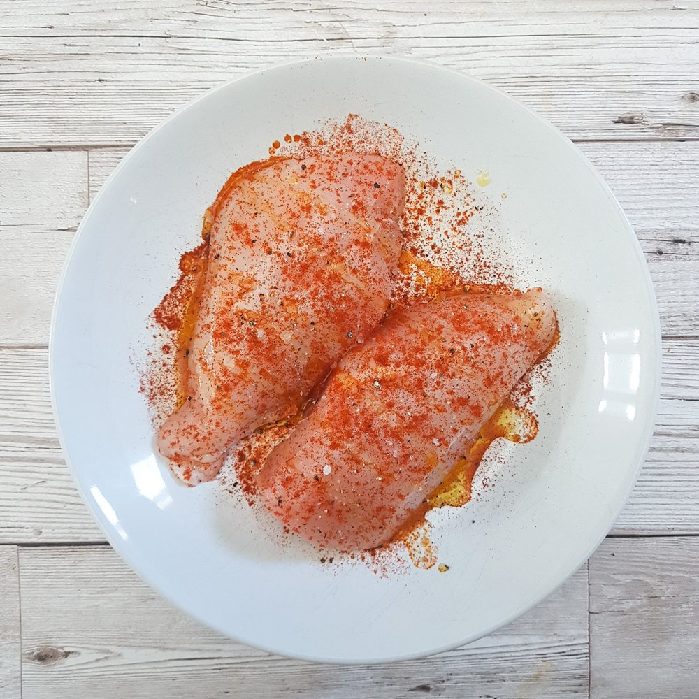 Place the chicken breasts in a bowl and season with a tsp smoked paprika, a oil, and a pinch of salt and pepper