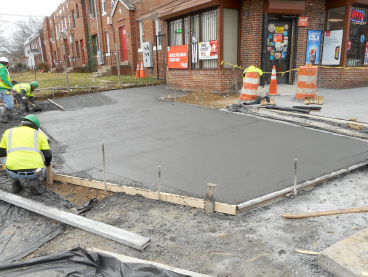 """Pouring 4"""" concrete for the ssidewalk at Sta.40+80RT"""