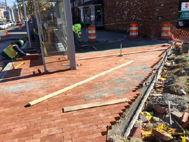 Brick sidewalk being placed on PCC base, station 35+60RT to 36+05RT