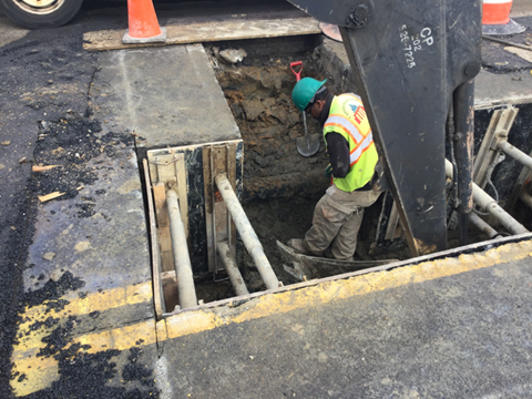 Excavation of roadway for installation of pipe connecting CB-16 to EX-MH.