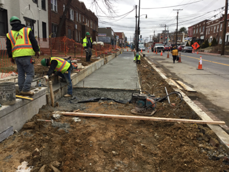 Placement of concrete for brick sidewalk and concrete stairs. station 36+84rt to 38+45rt.
