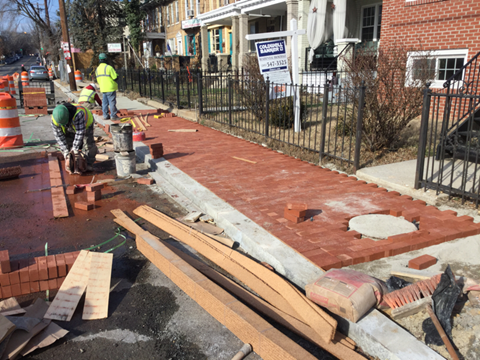 Installation of brick for brick sidewalk, Station 15+70LT to 17+02LT