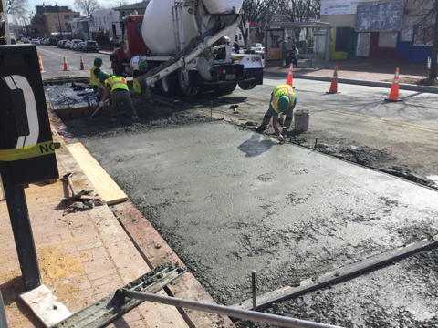 Concrete being poured for bus pad at stations 12+60LT to 13+20LT