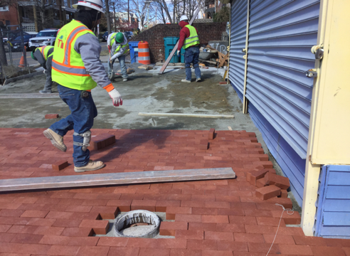 Contractor placing brick on brick sidewalk from Sta. 35+LT to 35+77 LT
