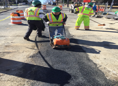 Asphalt placement on utility cut base from M-13 to M-16