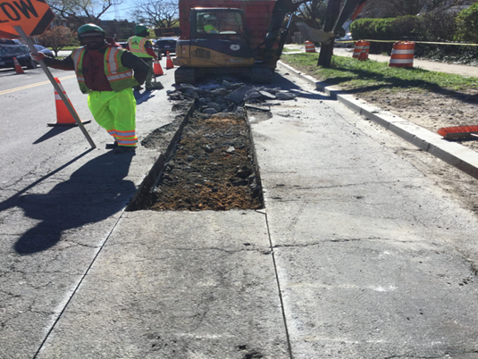 Capitol Paving excavation for the street light conduit trench from MH-13 to MH-14