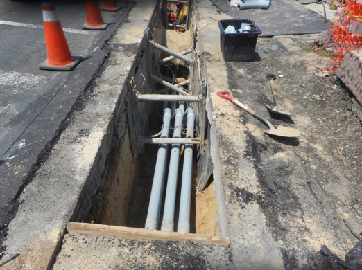 Installing conduit at the north-east corner of  Kansas Avenue and Missouri Avenue