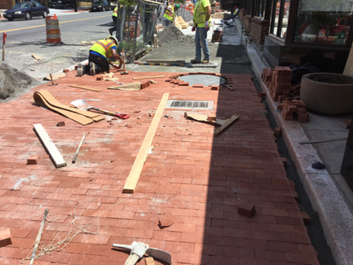 Contractor placing brick for brick sidewalk on PCC base, station 43+30RT to 43+85RT