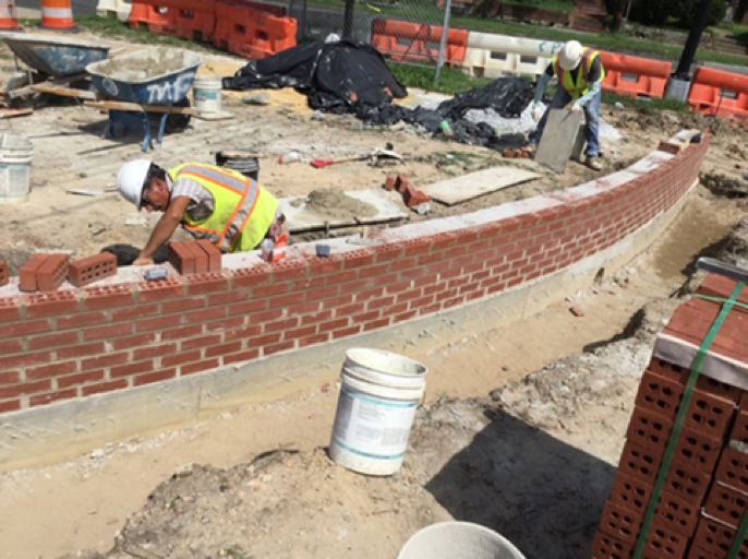 Curved brick clad wall at Missouri ave and Kennedy street island near EXXON gas station