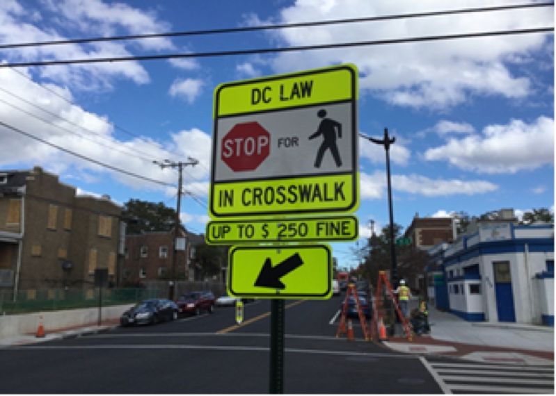 Installation crosswalk sign at Kennedy and 4th street intersection