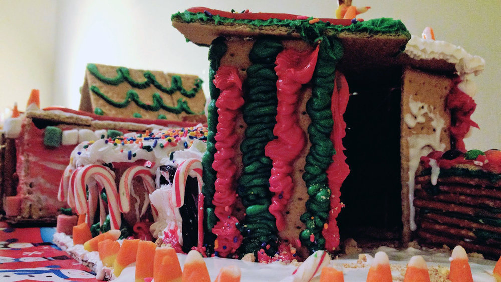 The students put their design and building skills to use in a friendly gingerbread house competition.