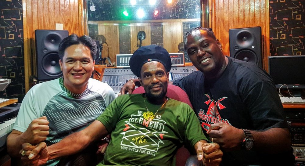 """Left to Right: Mark Loquan, Junior """"Ibo"""" Joseph, Seion Gomez in the studio"""