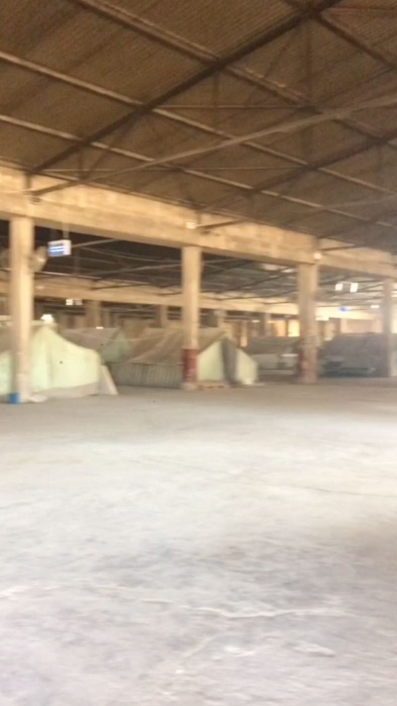 Residents live in tents in the warehouse.