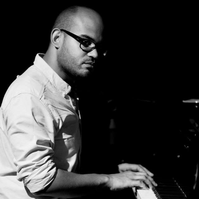 Ben B & W with piano.jpg
