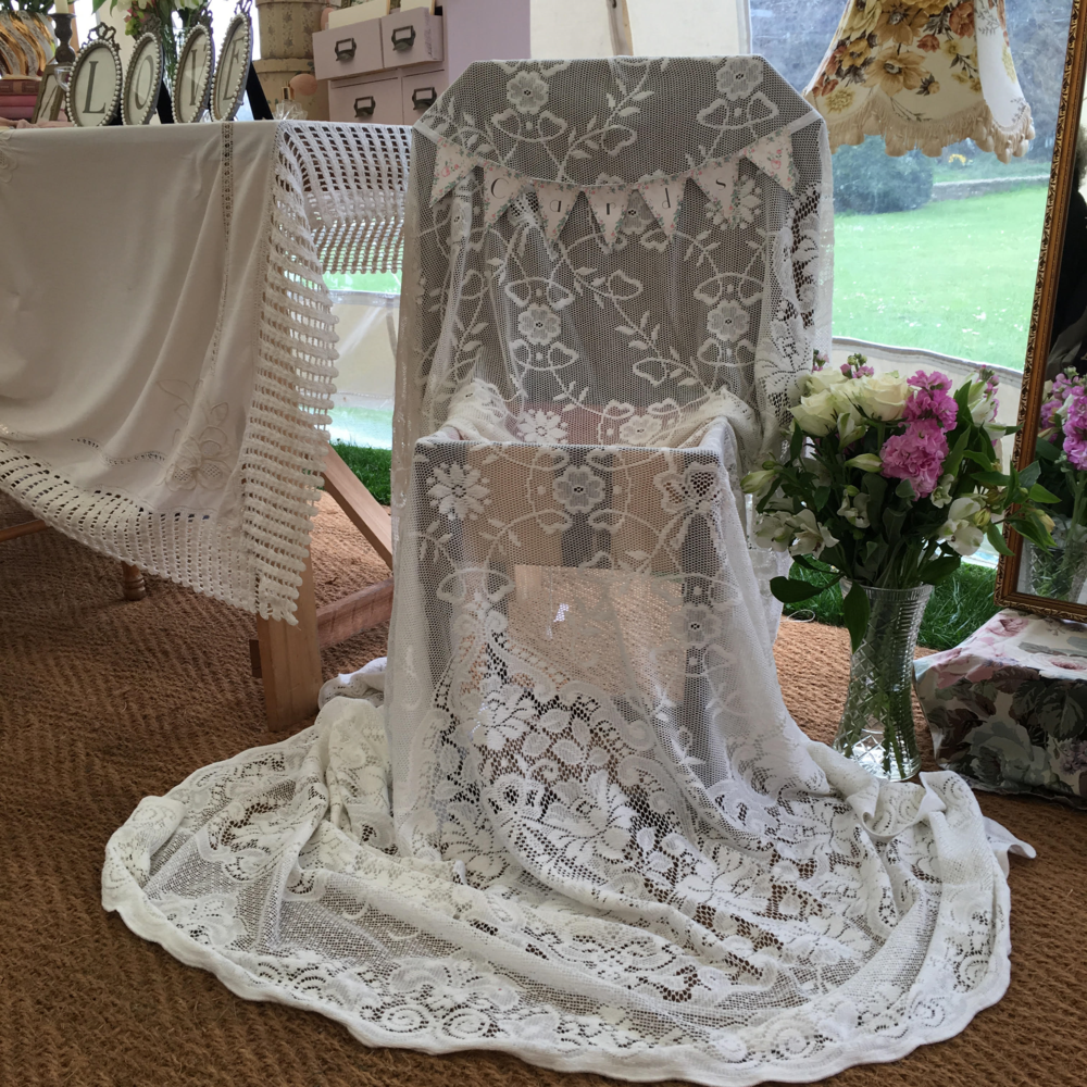 A lace covered card cabinet